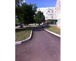 В м. Чугуєві проводиться поточний і капітальний ремонт внутрішньобудинкових доріг